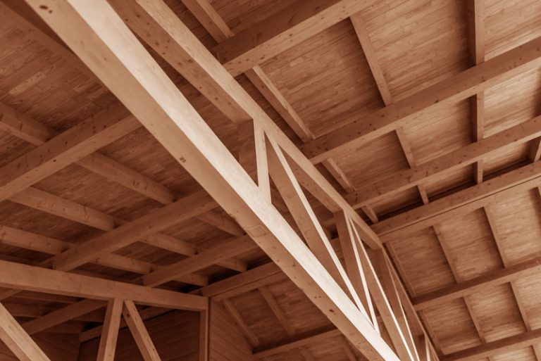 The construction of a wooden roof made of timber.